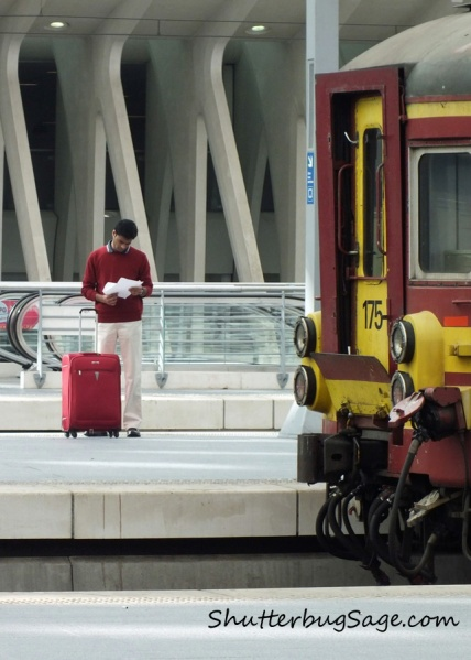 A traveler checks his ticket at the Liege Train Station in Belgium