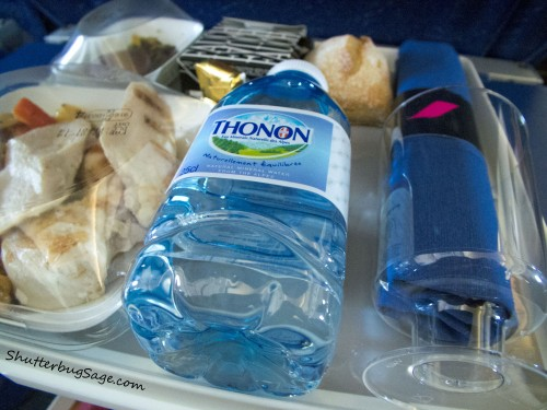 In flight meal between Amsterdam and Paris including bottled water and a sandwich