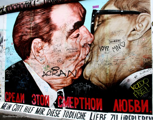 Brezhnev and Honecker kissing on a section of the old Berlin Wall that is now the East Side Gallery