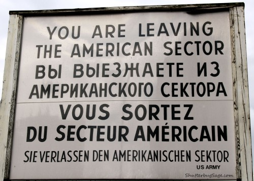 Leaving the American sector sign in English, Russian, French, and German at Checkpoint Charlie in Berlin