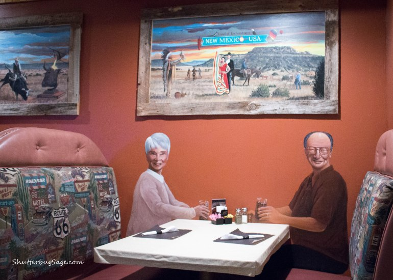 Murals by each booth at the Pow Wow Restaurant and Lizard Lounge in Tucumcari, New Mexico