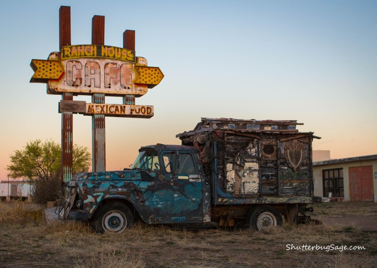 Dilapidated truck and the deteriorating marquee of the Ranch House Cafe in Tucumcari